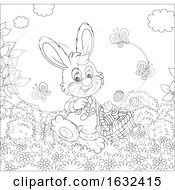 Black And White Rabbit With An Easter Basket On A Sunny Day