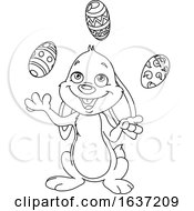 Cartoon Black And White Easter Bunny Juggling Eggs