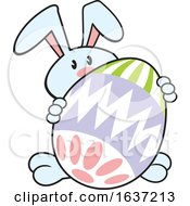 Cartoon Blue Easter Bunny With A Giant Egg