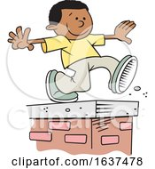Cartoon Black Boy Walking On Top Of A Brick Wall