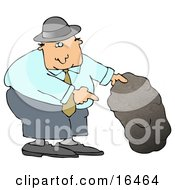 Caucasian Man In A Black Hat Blue Shirt Slacks And Gray Shoes Holding Up A Rock And Pointing Underneath It Clipart Illustration Graphic