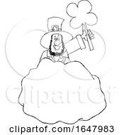 Cartoon Black And White St Patricks Day Leprechaun Holding Up A Shamrock Behind A Rock