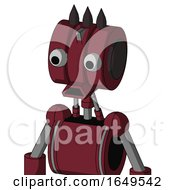 Red Droid With Multi Toroid Head And Sad Mouth And Two Eyes And Three Dark Spikes