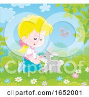 Little Girl Playing With A Bunny Rabbit
