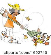Happy Black Woman Raking Leaves