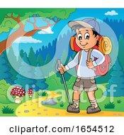 Boy Hiking On A Trail