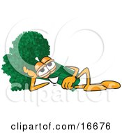 Green Broccoli Food Mascot Cartoon Character Resting His Head On His Hand While Lying Down On His Side