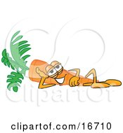 Orange Carrot Mascot Cartoon Character Relaxing And Resting His Head On His Arm While Lying On His Side