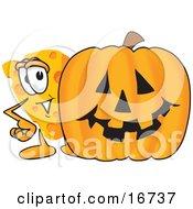 Wedge Of Orange Swiss Cheese Mascot Cartoon Character Standing By A Large Halloween Pumpkin