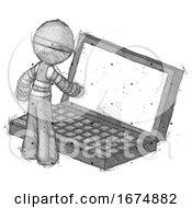 Sketch Thief Man Using Large Laptop Computer