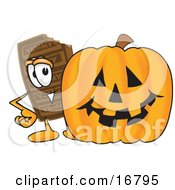 Chocolate Candy Bar Mascot Cartoon Character With A Carved Halloween Pumpkin