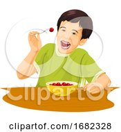 Boy Eating Grapes Using Fork