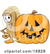 Clipart Picture Of A Scrub Brush Mascot Cartoon Character Standing By A Carved Halloween Pumpkin