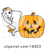 Tornado Mascot Cartoon Character Standing By A Halloween Pumpkin