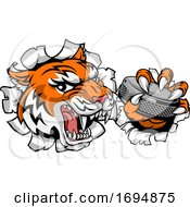 Tiger Ice Hockey Player Animal Sports Mascot by AtStockIllustration