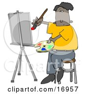 Black Male Artist Sitting On A Stool And Holding A Palette While Oil Painting A Portrait On A Canvas On An Easel