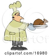 Male Caucasian Chef Carrying A Cooked Turkey On A Tray And Trying Not To Fall Asleep While Working