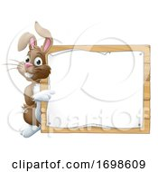 Easter Bunny Rabbit Peeking Around Sign Pointing