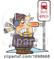 Cartoon Man Shivering At A Bus Stop In Winter