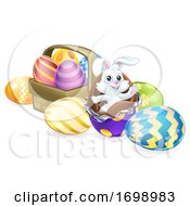 Easter Bunny Rabbit Breaking Out Of Chocolate Eggs