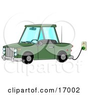 Environmentally Friendly Green Electric Car Parked In A Garage And Plugged Into An Electrical Socket While Charging