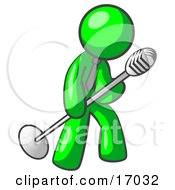 Lime Green Man In A Tie Singing Songs On Stage During A Concert Or At A Karaoke Bar While Tipping The Microphone