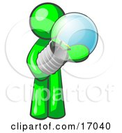 Lime Green Man Holding A Glass Electric Lightbulb Symbolizing Utilities Or Ideas