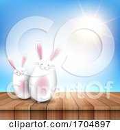 Easter Bunnies On A Wooden Table Looking Out To A Sunny Sky