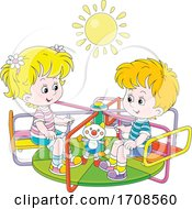 Children Playing On A Playground Merry Go Round