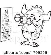 Cartoon Black And White Monster Taking An Eye Exam