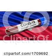 Flag Of Haiti Waving In The Wind With A Positive Covid 19 Blood Test Tube