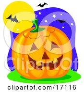 Carved Halloween Pumpkin Resting Under Vampire Bats That Are Flying In The Night Sky Clipart Illustration