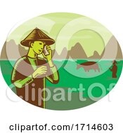 Vietnamese Farmer Wearing Conical Hat Talking On Mobile Phone