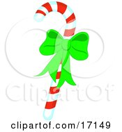 Christmas Peppermint Candy Cane With Red And Yellow Stripes And A Green Bow