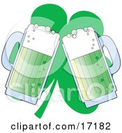 Two Green Mugs Of Beer Toasting In Front Of A Clover On St Paddys Day
