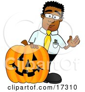 Black Businessman Mascot Cartoon Character With A Carved Halloween Pumpkin