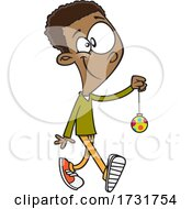 Cartoon Boy Carrying A Christmas Ornament