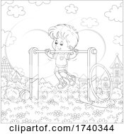 Boy Playing On The Monkey Bars In A Park
