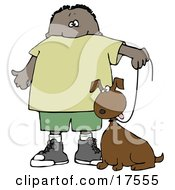 Little Hispanic Or African American Boy Walking His Brown Mutt Dog On A Leash