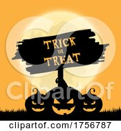 Full Moon And Jackolanterns With A Trick Or Treat Sign