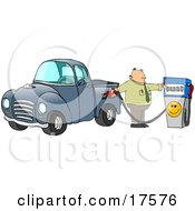 Frustrated Caucasian Business Man Flipping Off The Smiley Face On A Fuel Pump While Filling Up The Gasoline Tank Of His Blue Pickup Truck At A Gas Station