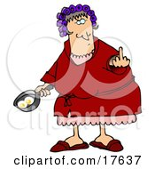 Angry Caucasian Woman A Wife With Her Hair Up In Curlers Holding A Frying Pan With Two Eggs In It And Flipping Off Her Husband
