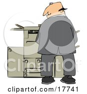 Mischievious Caucasian Businessman Urinating On A Copier Machine In An Office And Looking Back Over His Shoulder