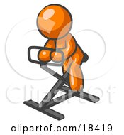 Orange Man Exercising On A Stationary Bicycle