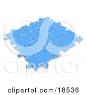 Blue Puzzle Pieces Connected Together Symbolizing Teamwork And Linking