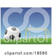 Poster, Art Print Of Black And White Soccer BallFootball Resting In Grass Near A Goal Post On A Soccer Field