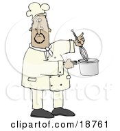 Mexican Male Chef Stirring Food In A Pot With A Whisk
