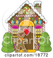 Clipart Illustration Of A Gingerbread Cookie Man Standing Between Bushes In Front Of A Christmas Gingerbread House by Maria Bell
