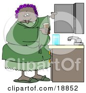 Clipart Illustration Of A Black Woman With Her Hair In Purple Curlers Wearing A Green Robe And Pjs Putting Medicine Back In The Cabinet In Her Bathroom