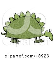 Green Dinosaur Like Tortoise With Spikes On His Shell